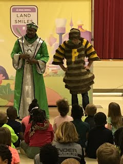 Tooth Wizard and Plaqueman with student volunteers from the audience